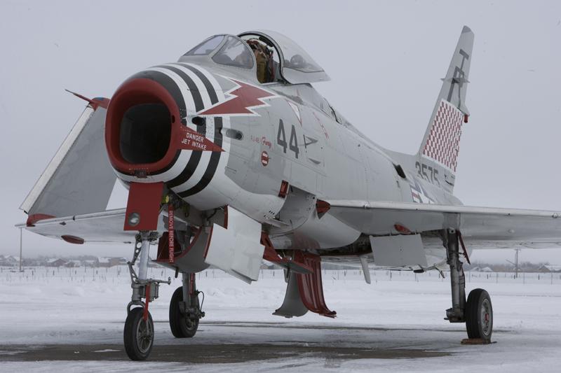 North American FJ-4 Fury folded wings on snowy runway