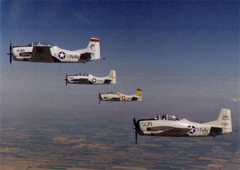 North American T-28 Trojan with other airplanes