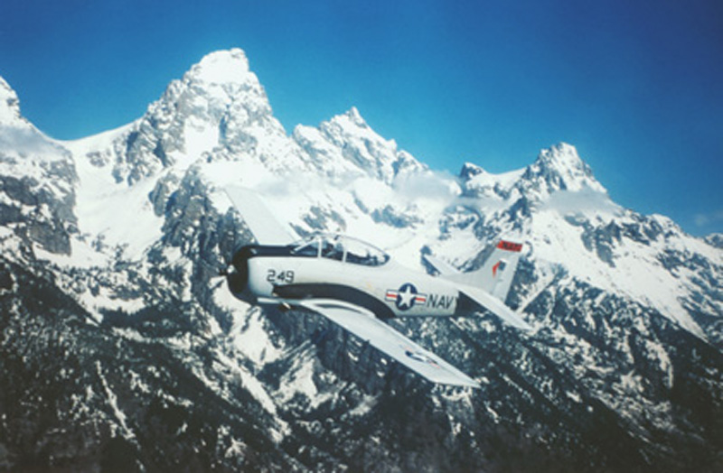 North American T-28 Trojan flying with teton mountains in background