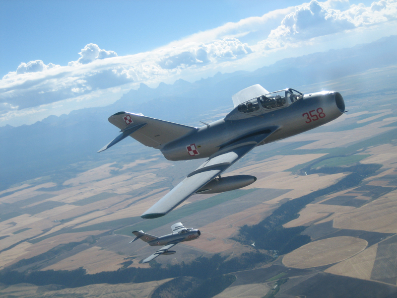 Mikoyan-Gurevich MiG-15 flying with tetons in background