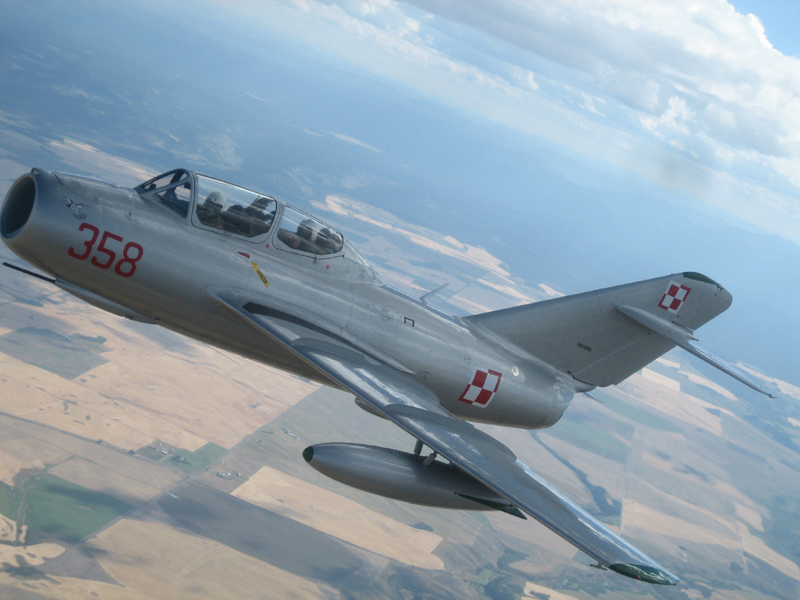 Mikoyan-Gurevich MiG-15 over fields
