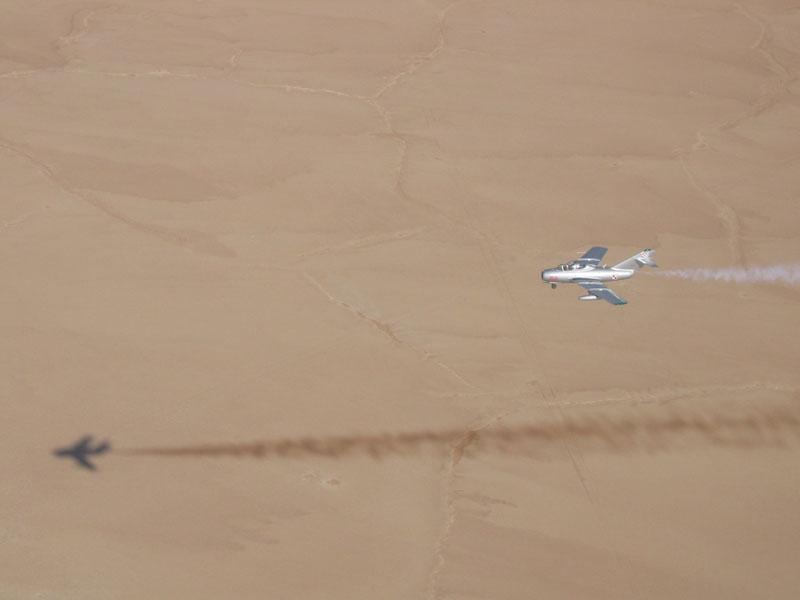 Mikoyan-Gurevich MiG-15 streaking over desert