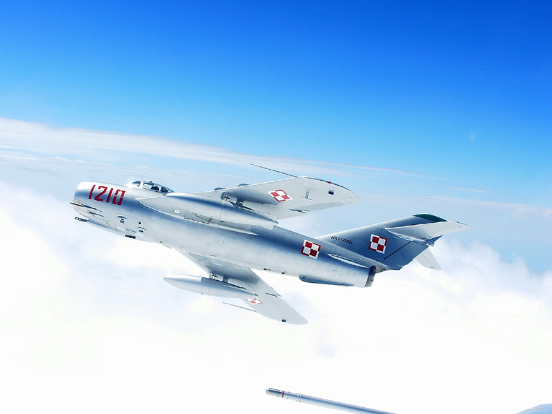 Mikoyan-Gurevich MiG-17 banking in clouds