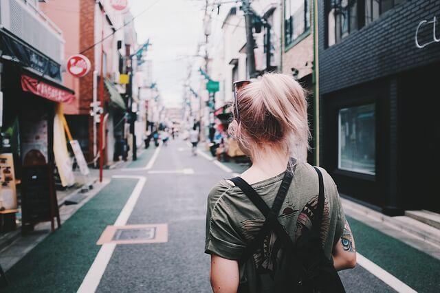 Woman walking down a city street.