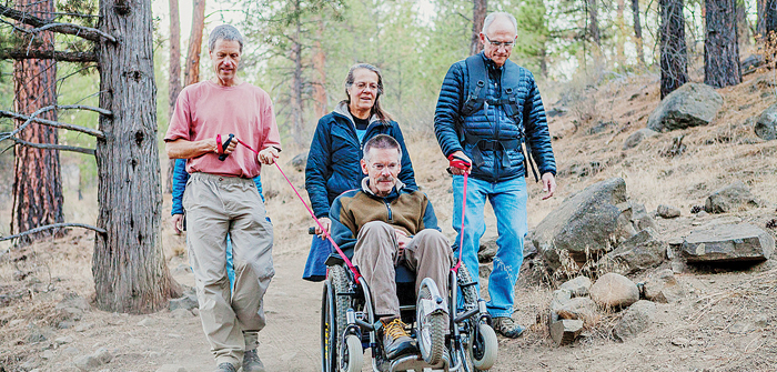 Geoff Babb with his wife Yvonne driving the original AdvenChair with friends on a recent outing in Shevlin Park