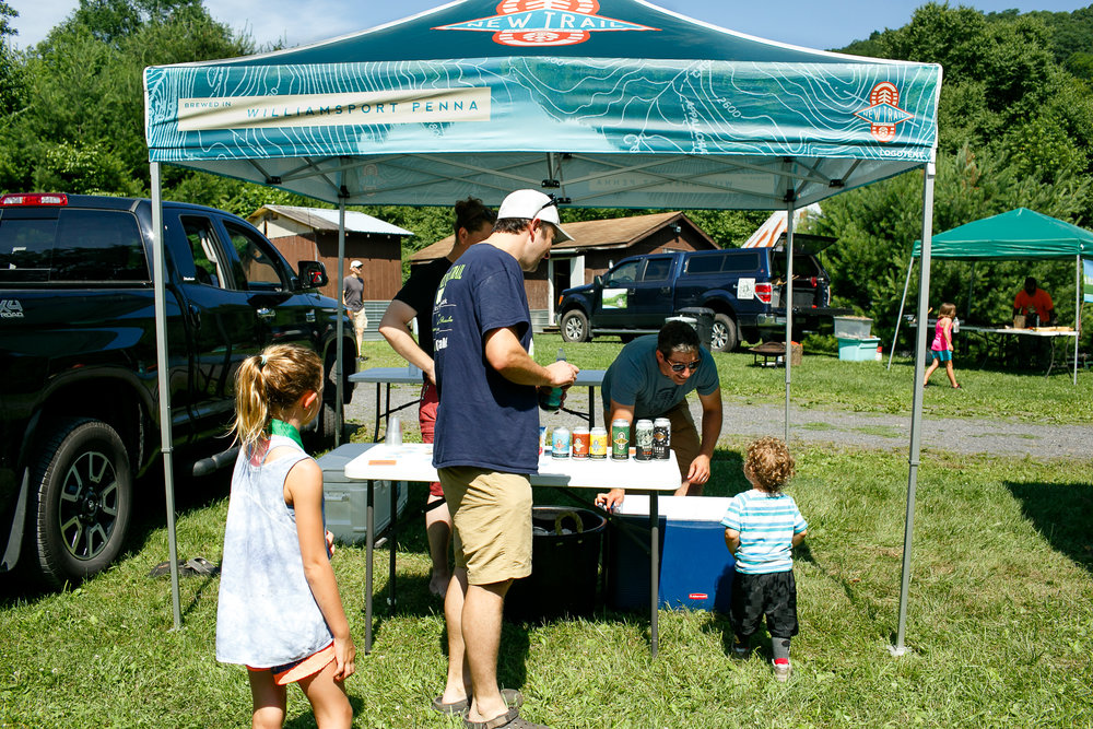 New Trail squad handing out beers (to the adults) and juice pouches at the 2018 Little Loggers Trail Fest.