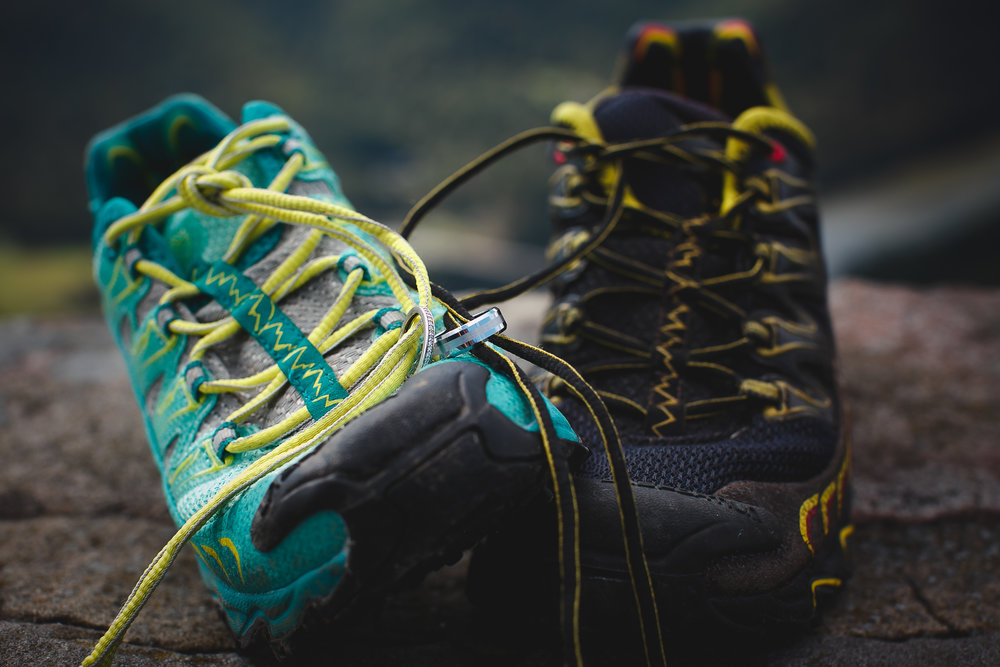 """Two of our PA Trail Dogs (Shaina & Norb Baier) tied the knot in September 2018. Their rings arrived at the ceremony bound to their favorite trail shoes — """"his and hers"""" La Sportiva Ultra Raptors."""