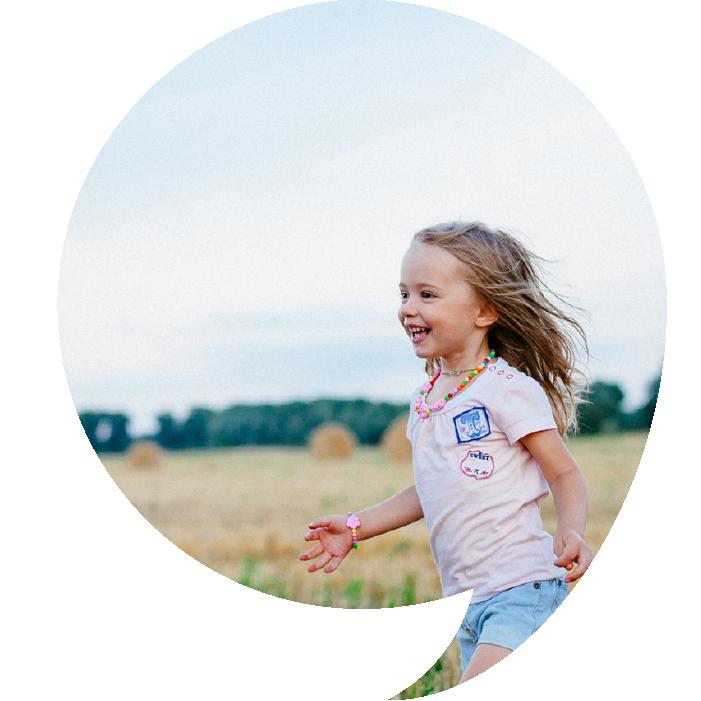 Girl in Grass in Speech Bubble Shape Kids Steps Coffs Harbour Speech Pathology.png