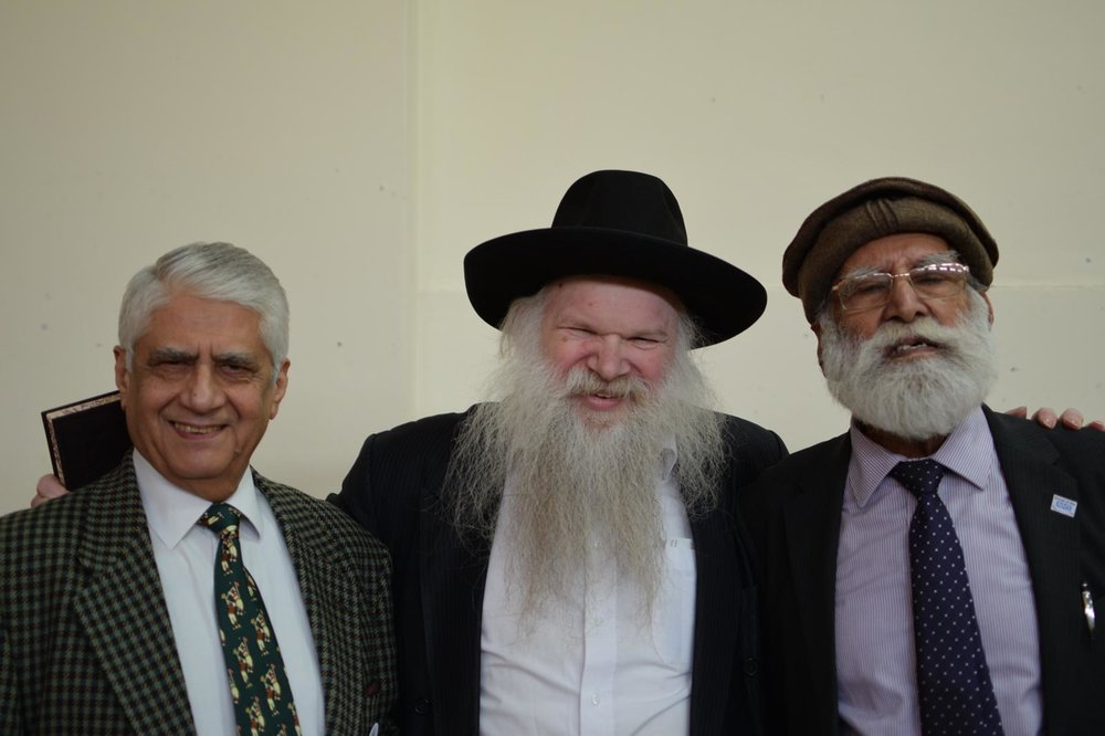 Rabbi Herschel Gluck with Bashir Chaudhry, chairman of the mosque which held the event.