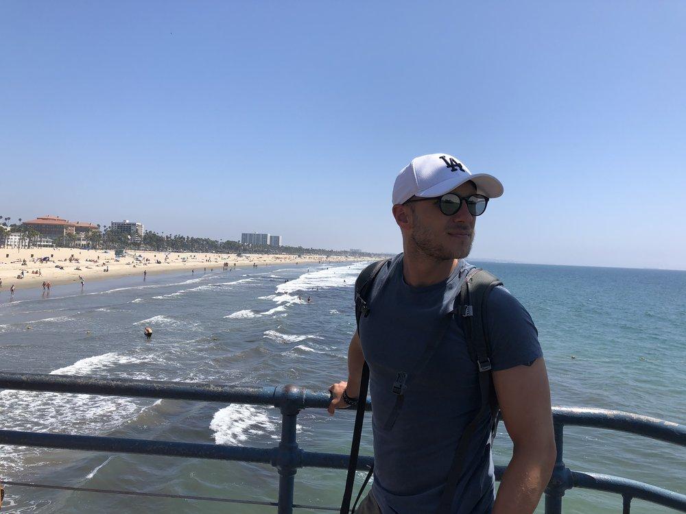 Yours truly in Santa Monica, CA.  New Era  cap, custom sunglasses,  Majestic Filatures  round neck tee.  Photo credit: @LucaMontini
