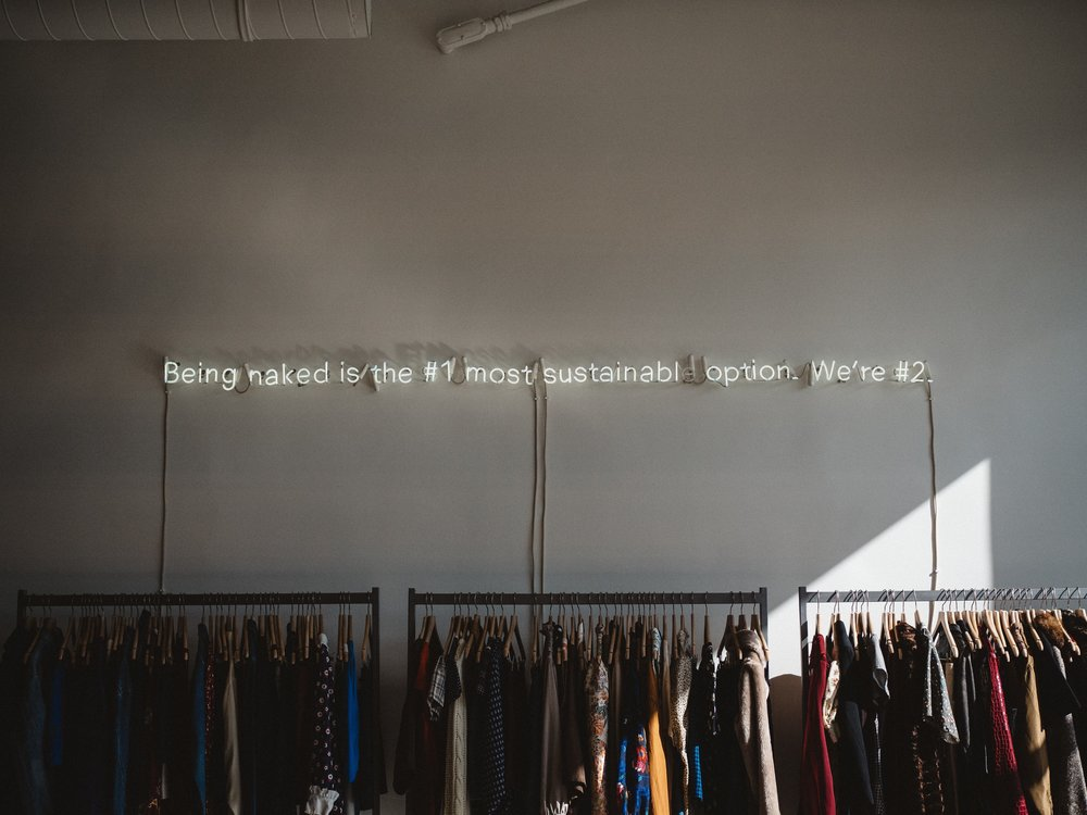 Super cool sign over some racks of ready-to-wear garments.  Phot Credit: @CharlesEtoroma