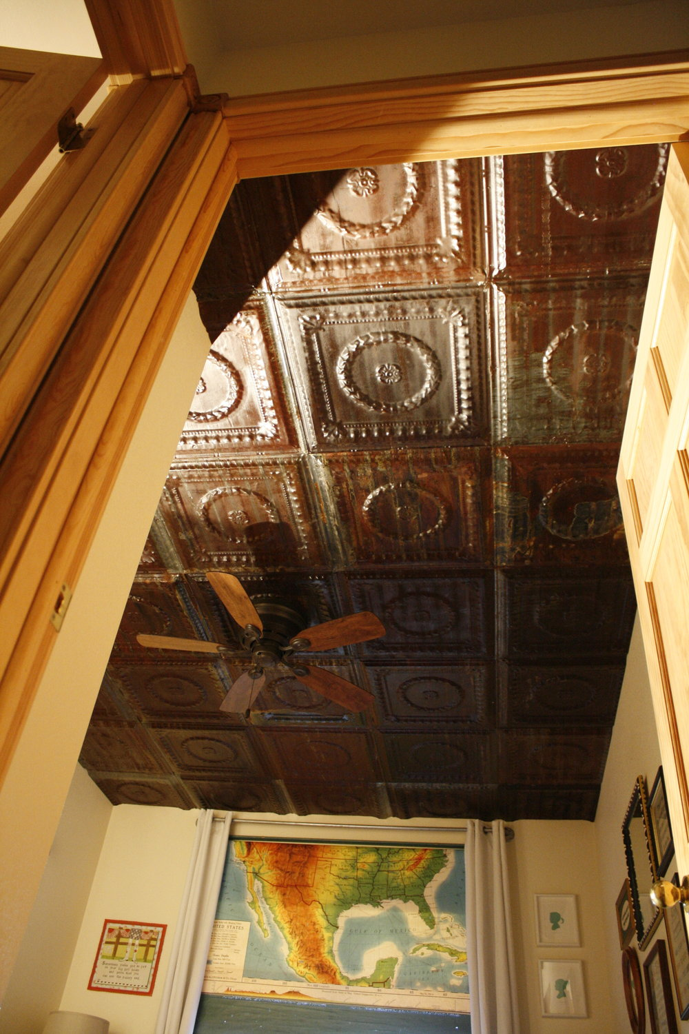 Close up of tin ceiling and varnish sealed