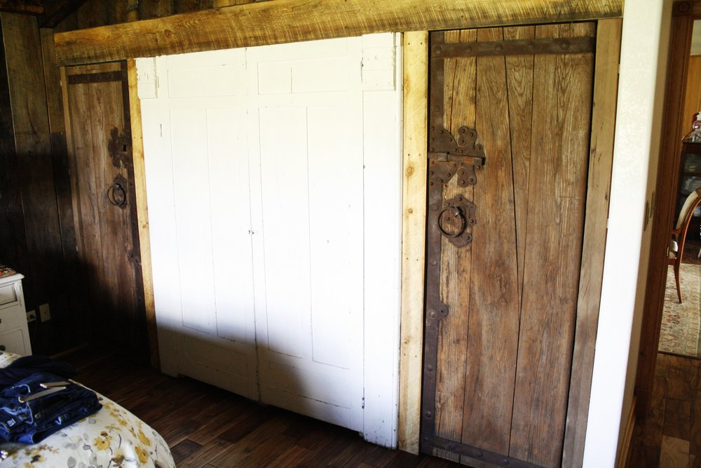 Incorporated current wardrobe in the wall and installed vintage doors