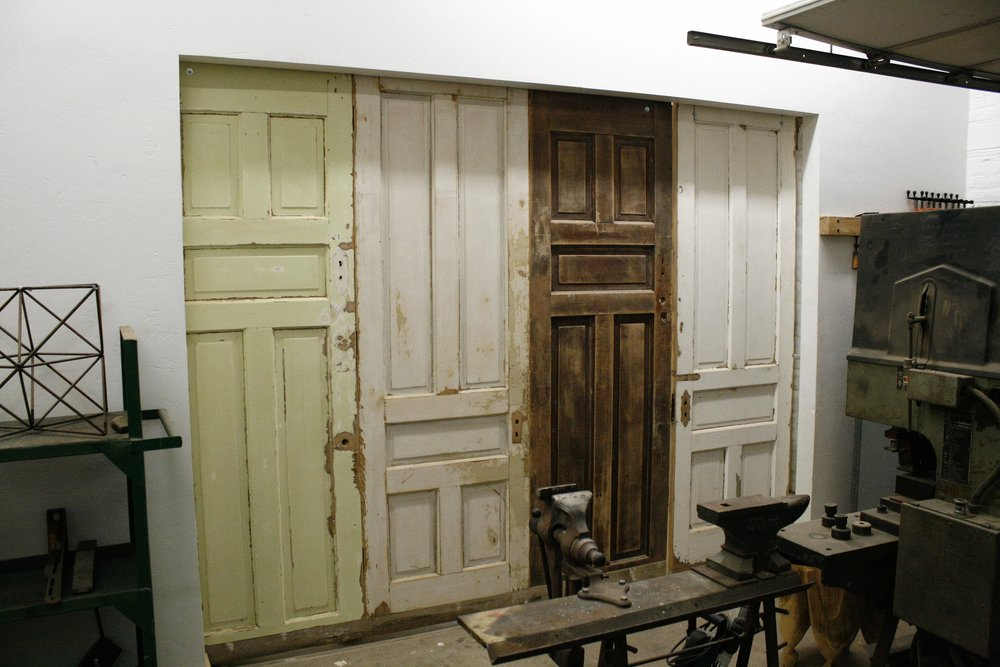 Sliding doors and track install from discarded doors
