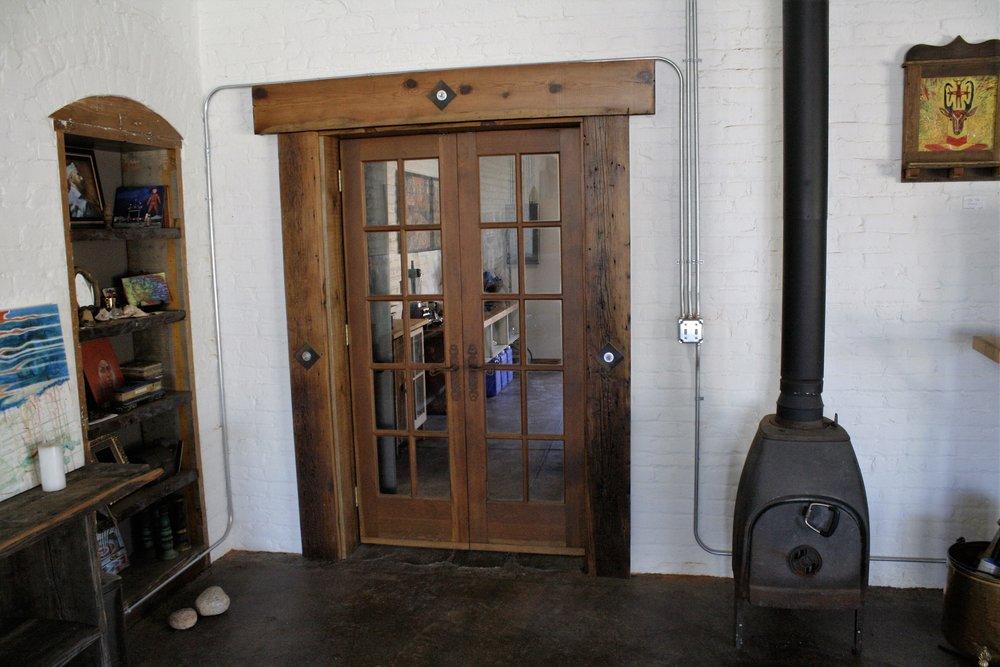 Custom made french doors, 2x8 reclaimed trim, wood stove install and inset bookshelf