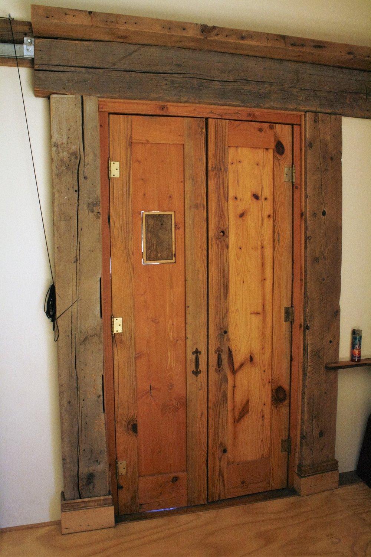Custom door from reclaimed heart pine and reclaimed wood trim