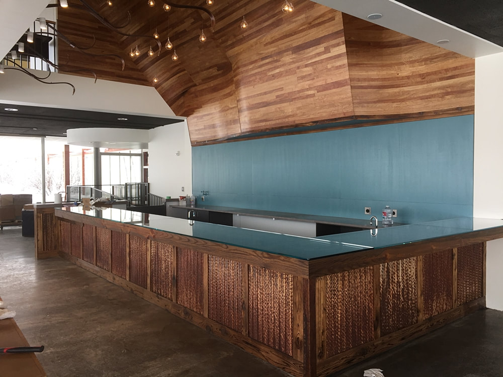 Overlook cafe bar sides are reclaimed metal from coal plant and hand burned cedar boards