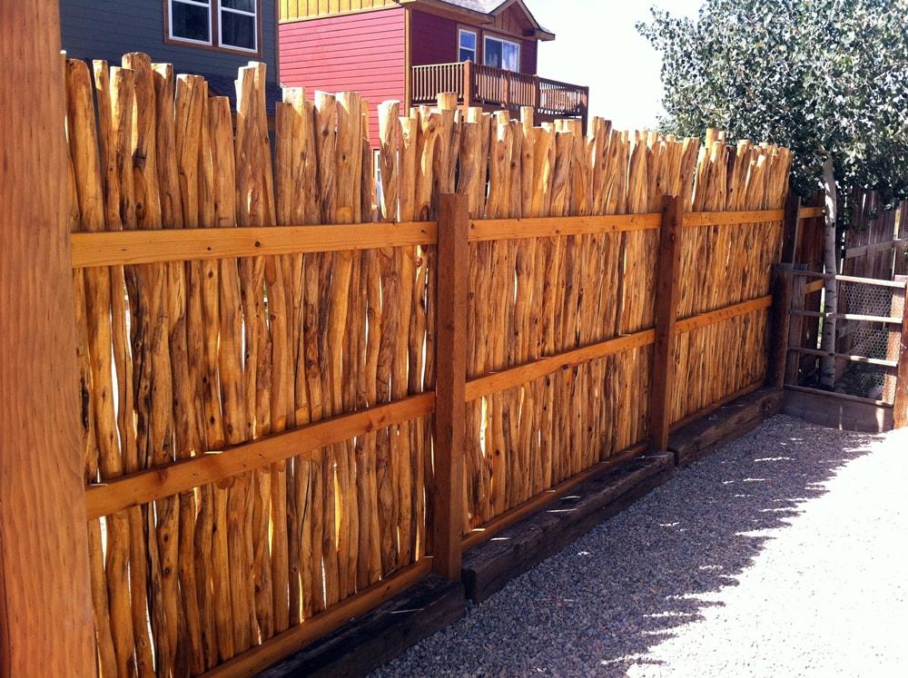 Hand peeled aspen log fence