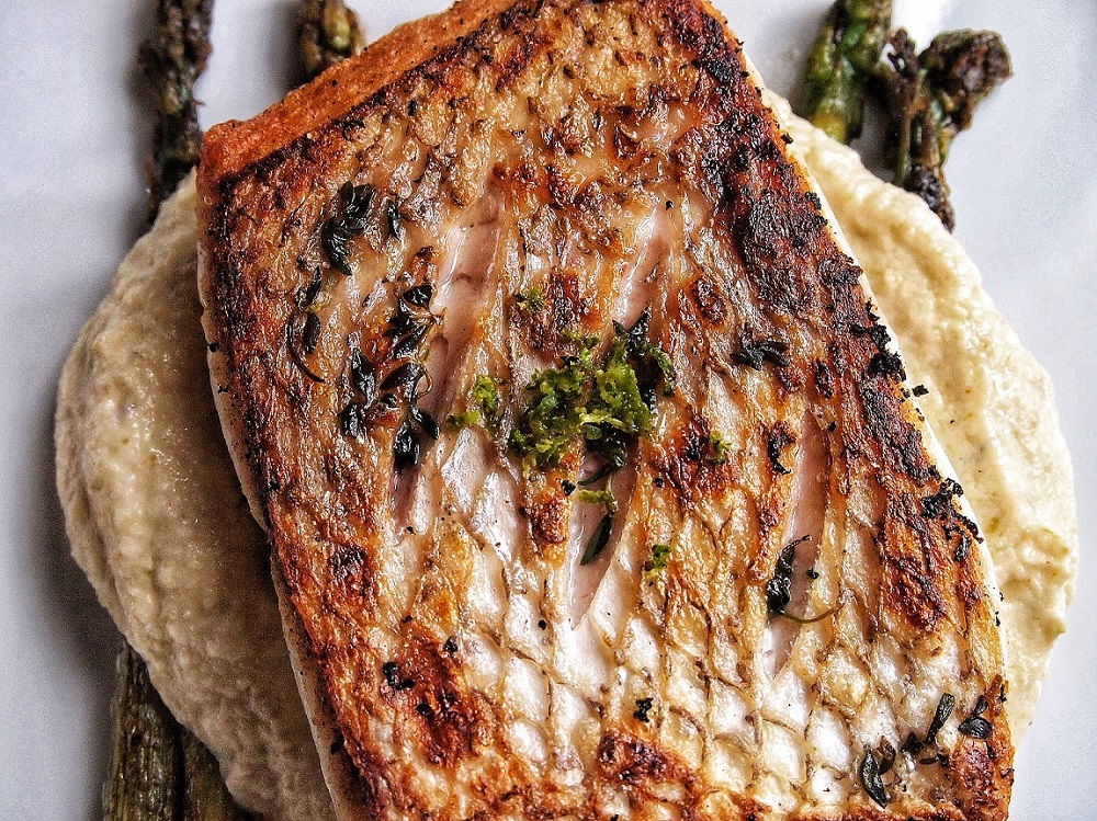Barramundi is perfectly cooked with the cauliflower roasted pepper puree and garlic lime asparagus