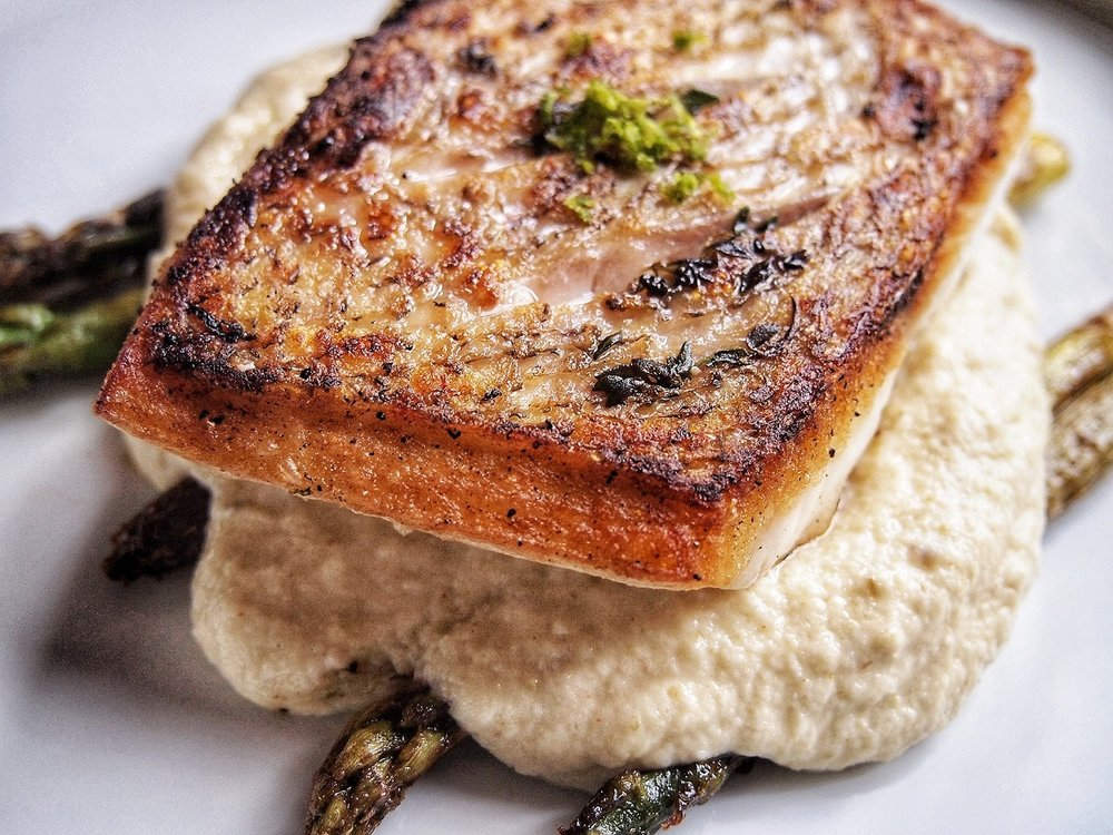 Another close up of the barramundi that is perfectly cooked with the cauliflower roasted pepper puree and garlic lime asparagus