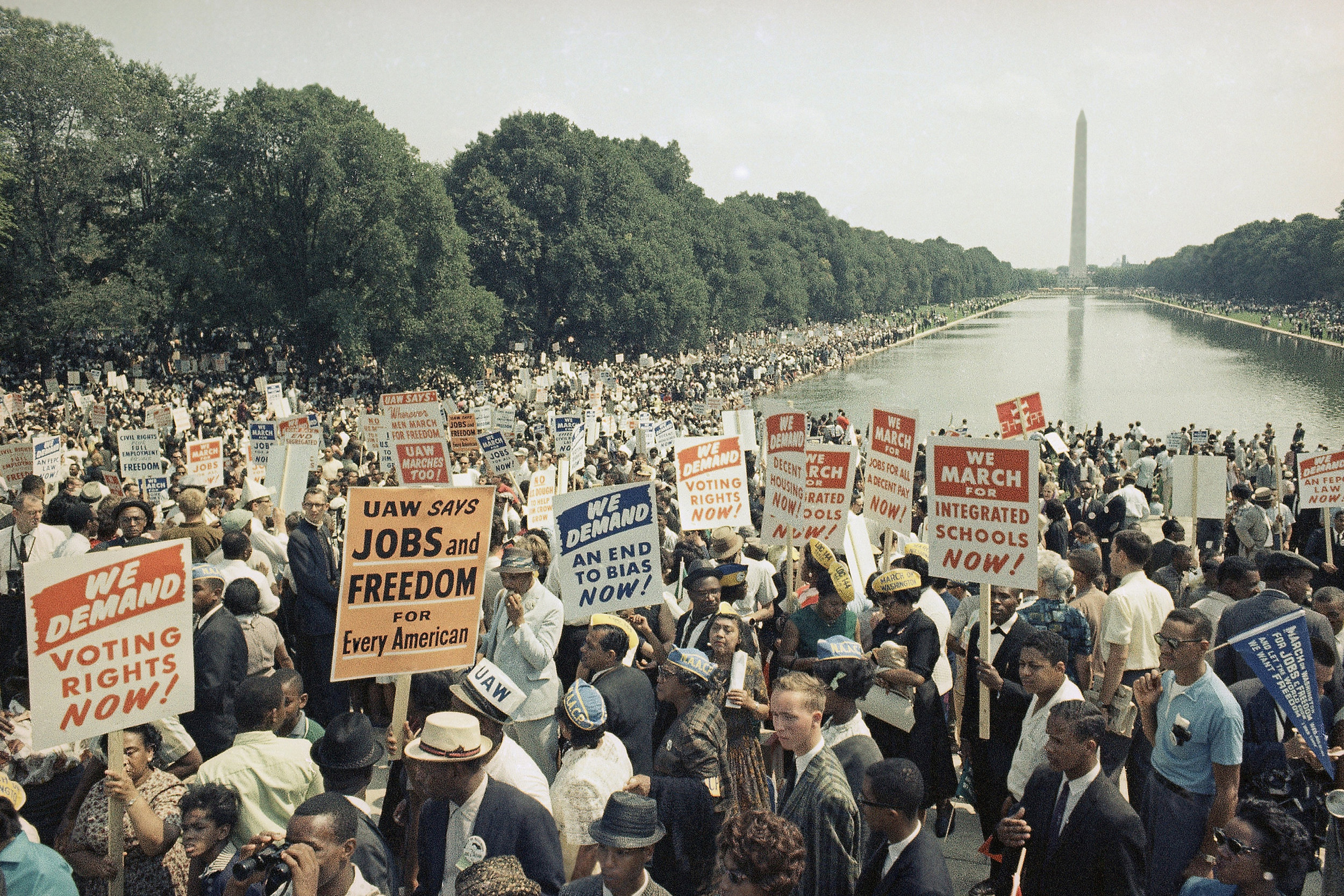 Large crowds gather at the Washington Monument and around the reflecting pool to demonstration for civil rights in Washington, D.C., on August 28, 1963. (AP Photo)