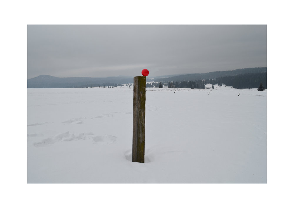 Tiny Domingos -  Red ball on woodbar winter landscape,  Archival digital print (2018)