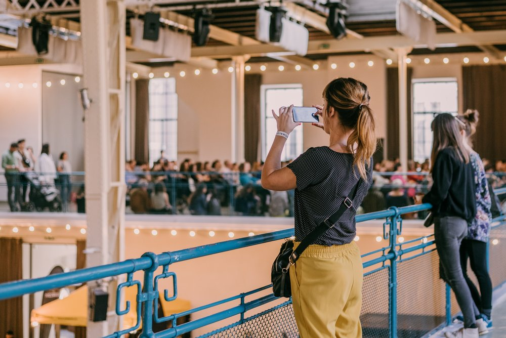 woman-taking-a-picture-of-an-event-venue-with-her-mobile-phone_t20_pxkY2j.jpg