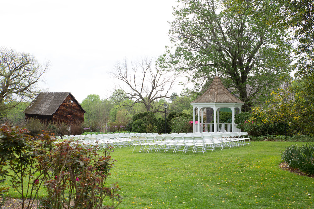 Fully staged outside wedding are on rear lawn.