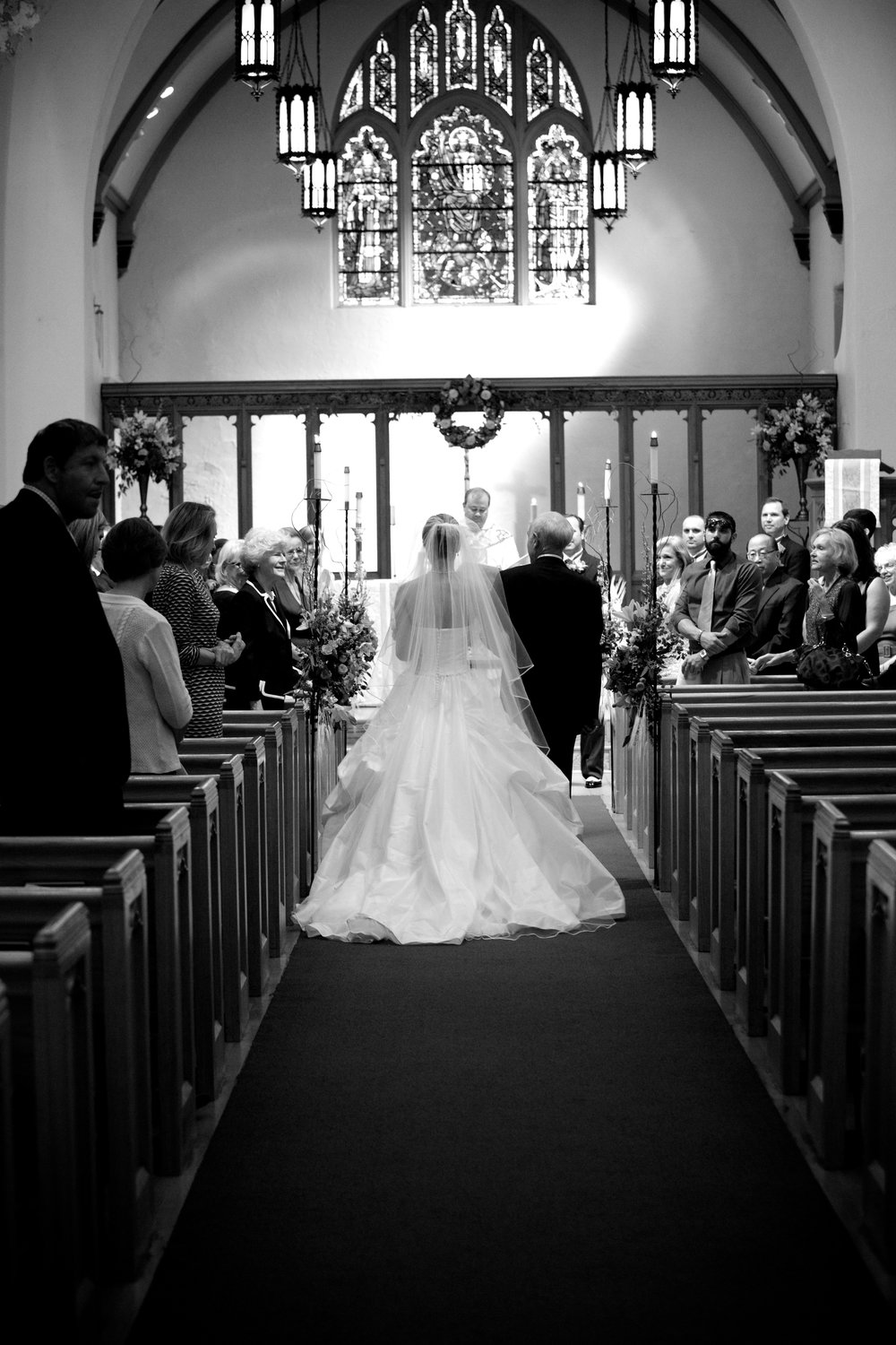 The father of the bride escorts her down the aisle.
