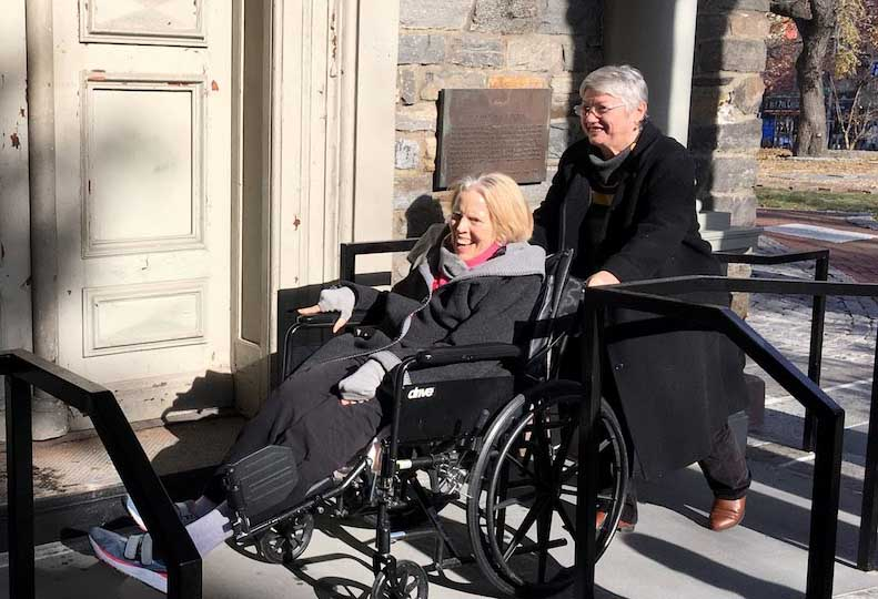 St. Mark's parishioner Linda Tarnay enjoys the church's new ramp for the first time.