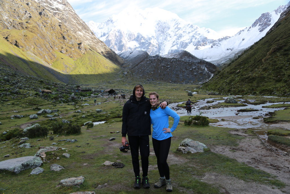 Standing in front of Salkantay Glacier during the Salkantay Trek to Machu Picchu.