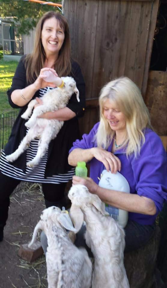 Janelle and Vanessa bottle feeding.jpg