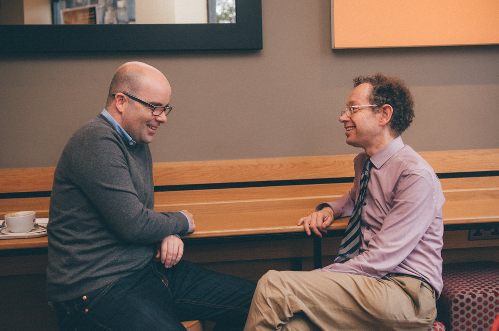Two Cornerstone members chatting over coffee