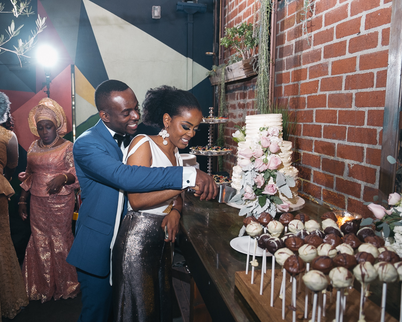 eniola and lumi wedding with cluster events cake.jpg