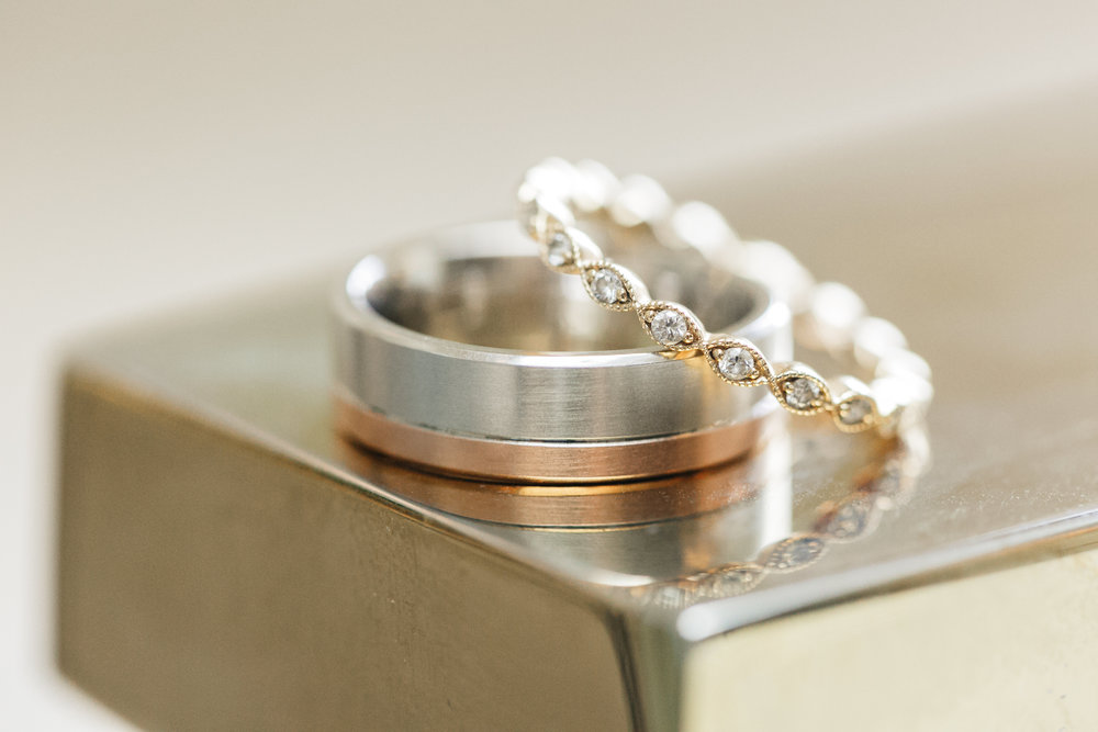 shadee and courtlan wedding with cluster events rings.jpg