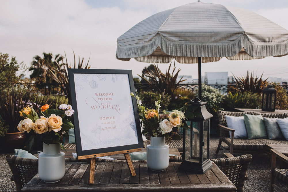 sophie and arick wedding with cluster events signage.jpg