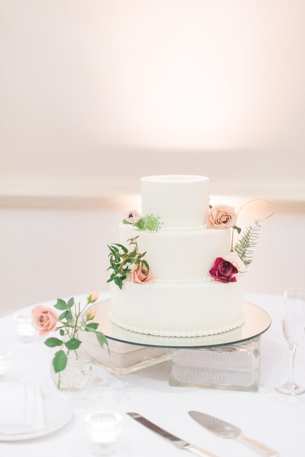 susan and michael wedding with cluster events cake.jpg