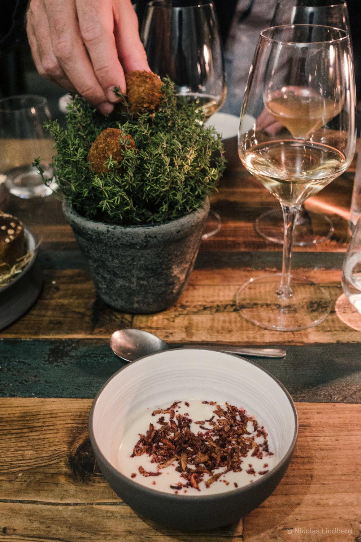 Jerusalem artichoke soup, crispy artichoke, cranberry. Mushroom croquettes on a bush