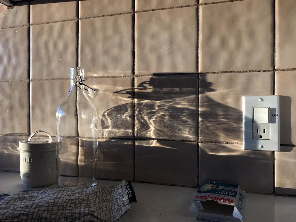 Morning sunlight on kitchen tiles, North Vancouver © Tanya Clarke 2019