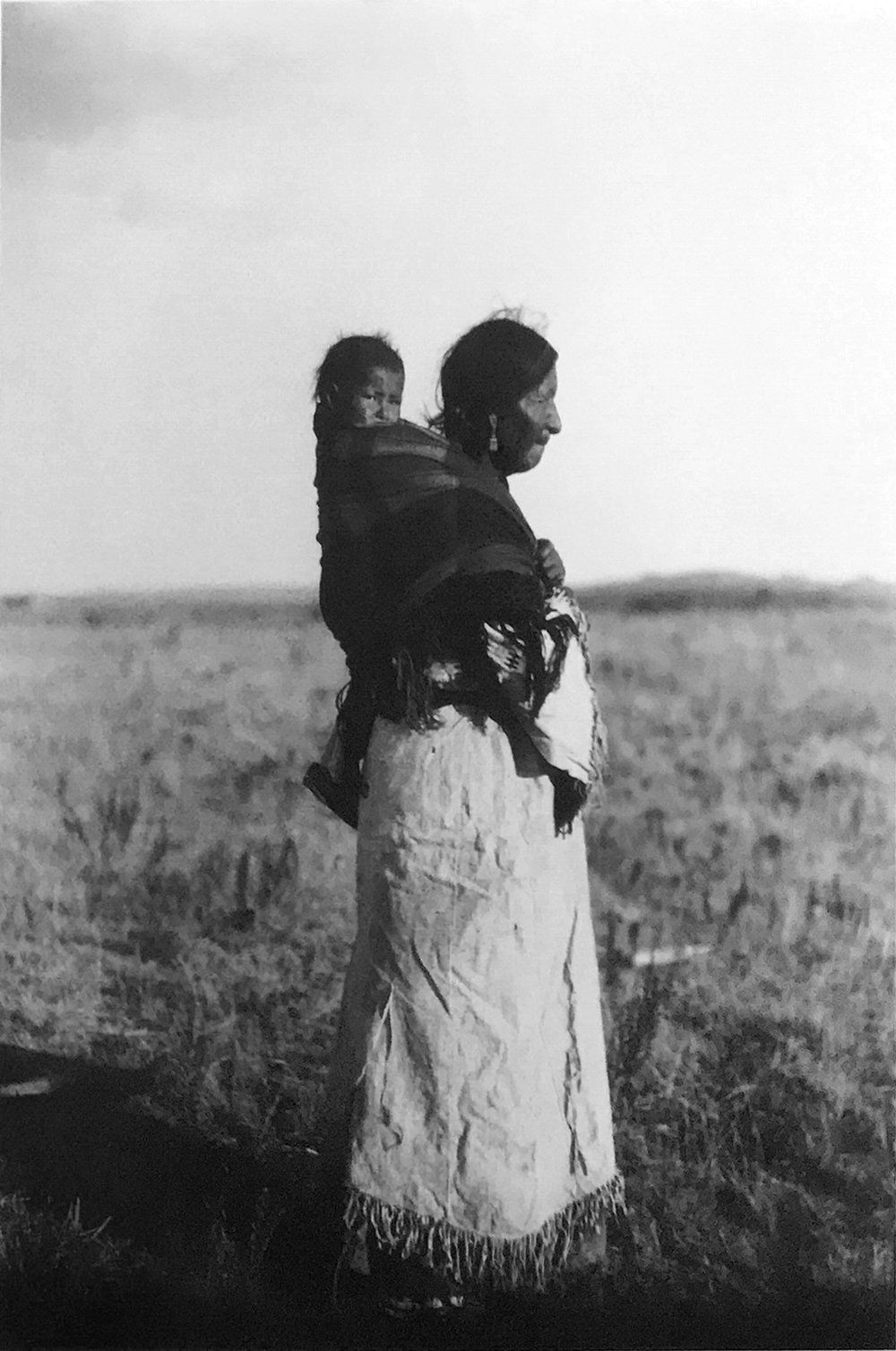 Postcard photograph: Lakota woman & child. The Lakota are matrilineal and children belong to the mother's clan. Traditionally women controlled the food resources and movable property. Photo circa 1910 .  nativenorthwest.com