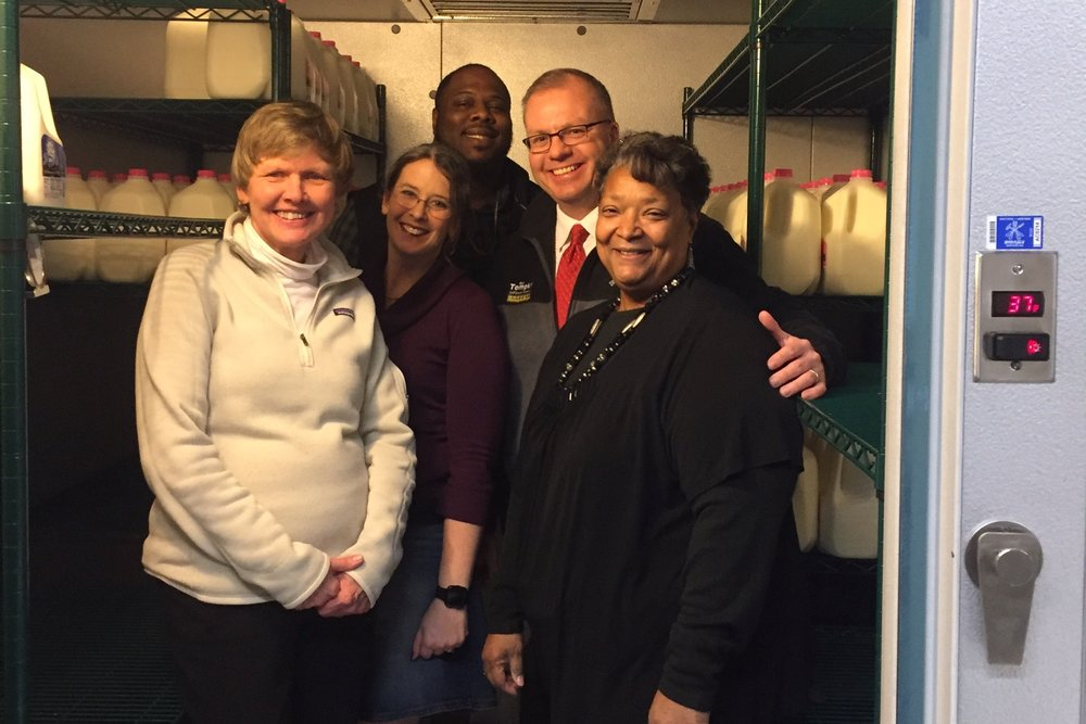 Albion-Homer United Way Board Members and Laura Overholt, Food Hub Manager, assist with the fresh food distribution at the Albion Food Hub.  L to R: Marcia Starkey, Laura Overholt, Mike Culliver, Gary Tompkins, Carolyn Amos.