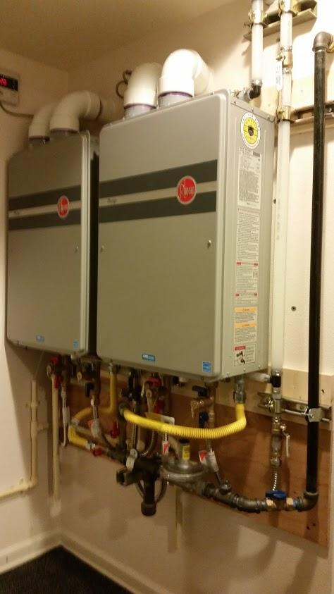 Side by side tankless water heaters in series for restaurant