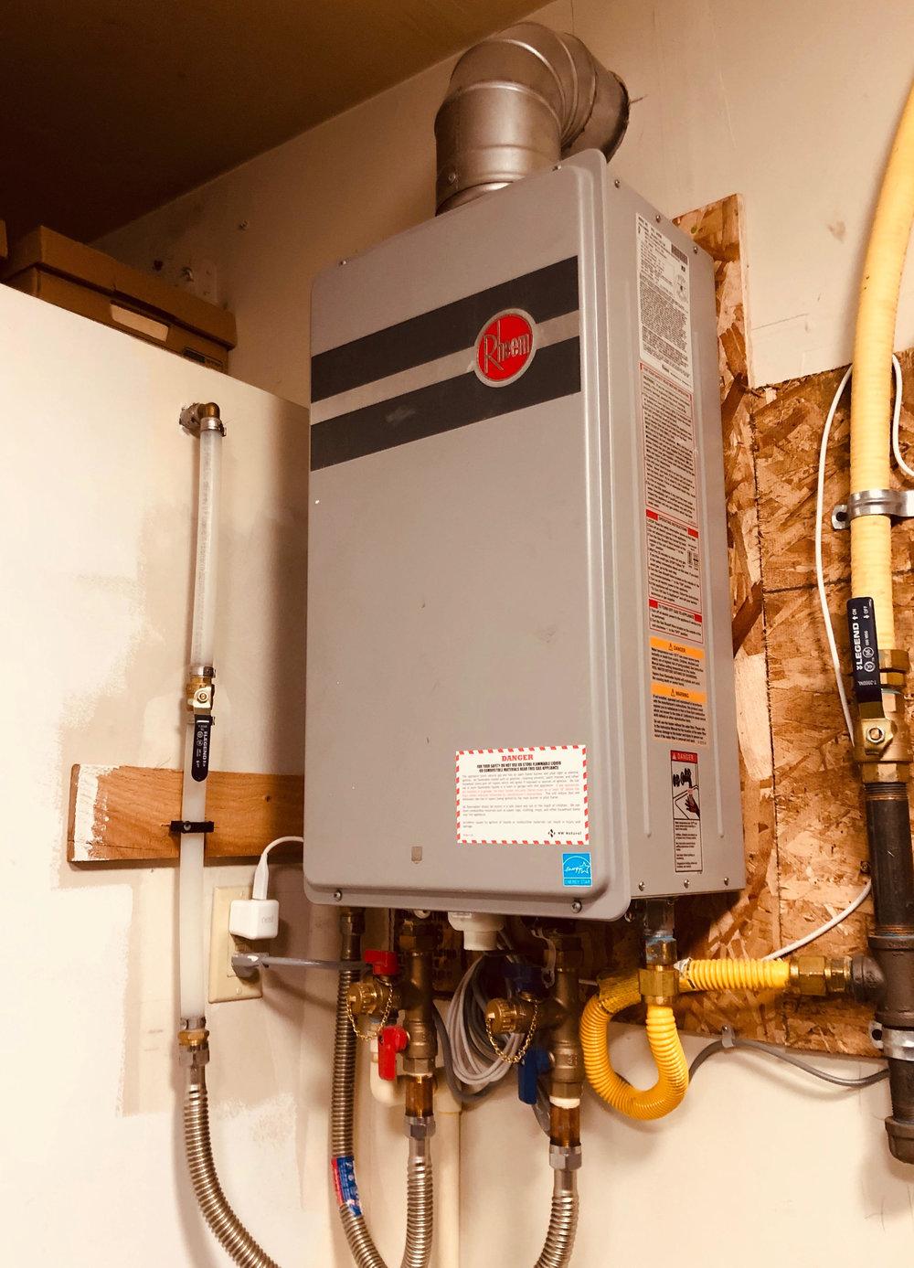 Residential tankless water heater install Rheem