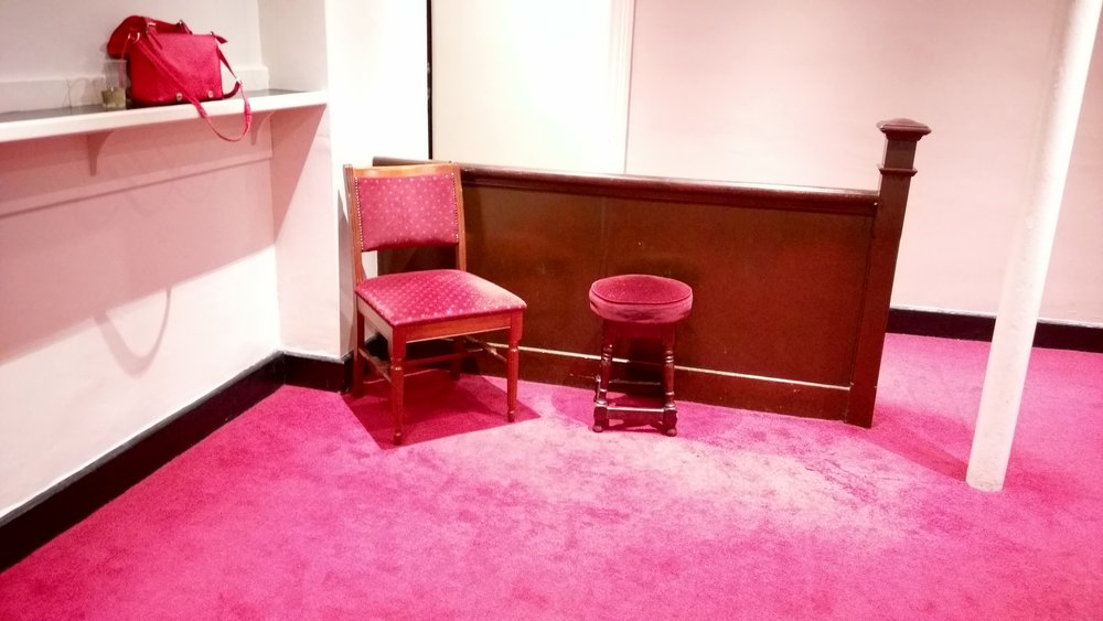 Two of the four chairs in the balcony bar at the Theatre Royal Drury Lane