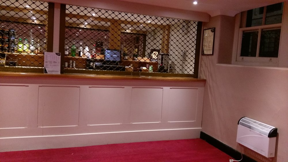 Prison-like bar in the balcony at the Theatre Royal Drury Lane