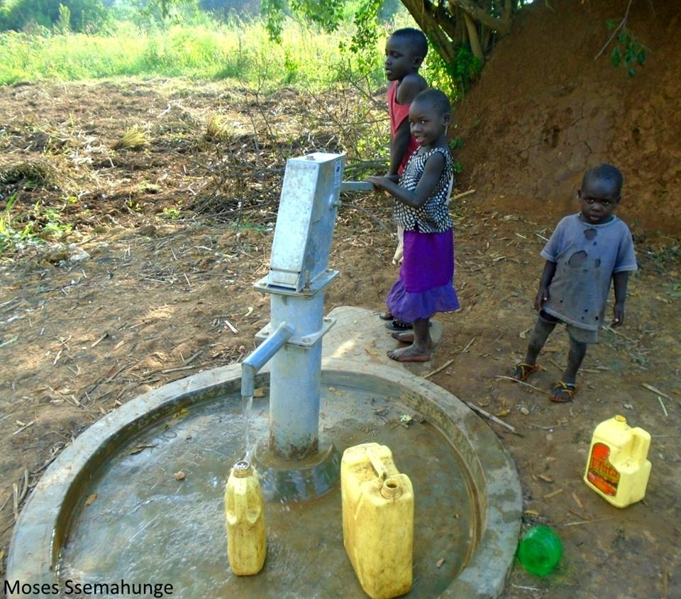 kids using borehole.jpg