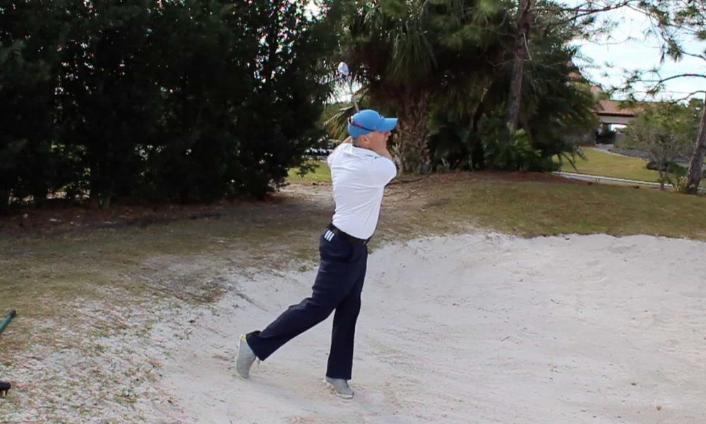 How to Hit a Downhill Bunker Shot