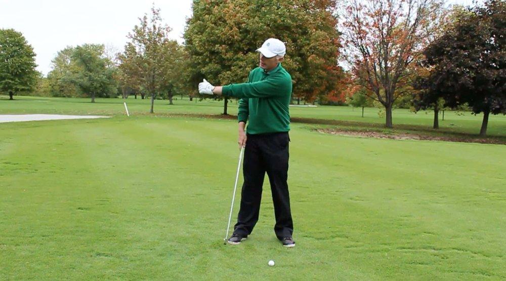 left arm in golf swing