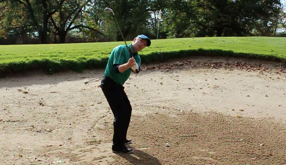Face rotation bunker shot backswing