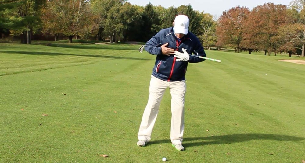 How to hit the downhill lie golf shot